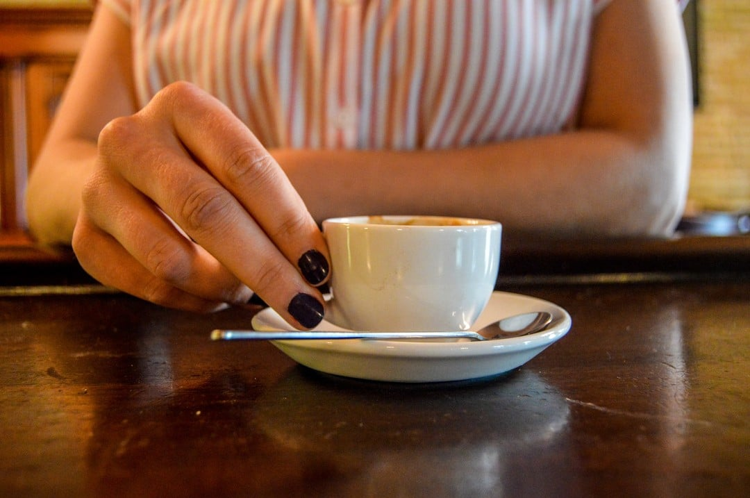 person holding espresso cup